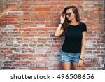a hipster girl with long brown... | Shutterstock . vector #496508656