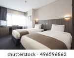 Stock photo a hotel room bedroom with two beds curtain lighting front view at the day in seoul south korea 496596862