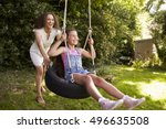 mother pushing daughter on tire ... | Shutterstock . vector #496635508