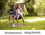 Portrait Of Two Girls Playing...