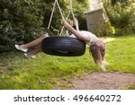Young Girl Playing On Tire...