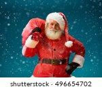 Smiling Santa Claus Carrying...