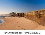 bamburgh castle with rocks.... | Shutterstock . vector #496738312