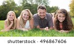 family with two girls on grass... | Shutterstock . vector #496867606