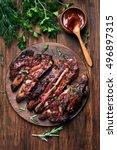 grilled sliced barbecue pork... | Shutterstock . vector #496897315