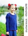 happy schoolgirl in warm cozy... | Shutterstock . vector #496943698