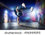 young man break dancing at... | Shutterstock . vector #496949095