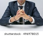 businessman with handcuffs | Shutterstock . vector #496978015