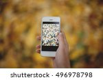 female hand holding modern...   Shutterstock . vector #496978798