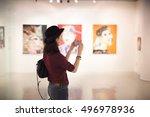 Woman Visiting Art Gallery...