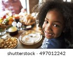 little girl eating thanksgiving ... | Shutterstock . vector #497012242