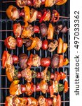 barbecue kabobs smoking on the... | Shutterstock . vector #497033362