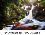 mystical small waterfall in the ... | Shutterstock . vector #497096056