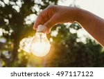 hand holding a light bulb with... | Shutterstock . vector #497117122