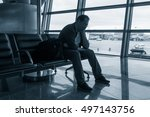 sad man waiting for delayed... | Shutterstock . vector #497143756