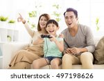 laughing family playing video... | Shutterstock . vector #497198626