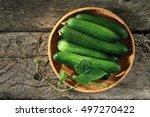 Cucumber Basket On Wooden...