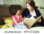 mother parenting daughter... | Shutterstock . vector #497272282