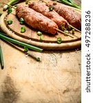 raw kebab with green onions on...