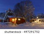 snowed up wooden cabin on a... | Shutterstock . vector #497291752