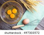 top view of eggs in bowl on wood | Shutterstock . vector #497303572