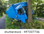 A Truck Crashed Against A Tree...