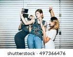 three female friends posing in... | Shutterstock . vector #497366476