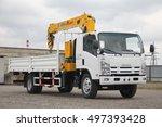 a white isuzu flatbed truck...   Shutterstock . vector #497393428