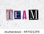 team word cut from newspaper on ... | Shutterstock . vector #497421295