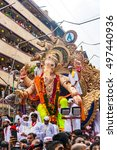 Small photo of MUMBAI, INDIA - SEPTEMBER 15, 2016 : Devotees bids adieu to Lord Ganesha as the ten-day-long Hindu festival ends in Mumbai.