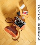 Small photo of PARIS, FRANCE - MAY 11, 2015: Fed film camera with AGFA film on wooden background