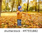 little adorable boy in yellow... | Shutterstock . vector #497551882