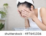 woman washing her face | Shutterstock . vector #497641336