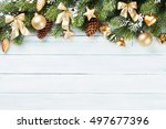 christmas wooden background... | Shutterstock . vector #497677396