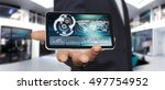 businessman holding multimedia...   Shutterstock . vector #497754952