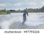 young male athlete glides on... | Shutterstock . vector #497793226
