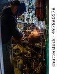 welder brews metal | Shutterstock . vector #497860576