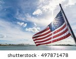 American Flag Waving With The...