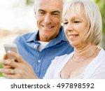 happy senior couple looking at...   Shutterstock . vector #497898592