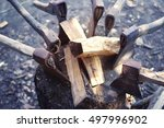 Old Axes In A Woodpile With...