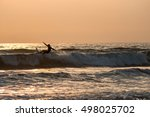 Silhouette  Of Surfer Catching...
