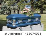 A Blue Casket At A Small...