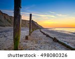 Sheringham Beach And Cliffs At...
