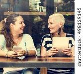 women using digital device... | Shutterstock . vector #498129145