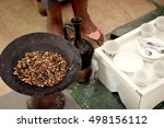 roasting fresh coffee beans in... | Shutterstock . vector #498156112