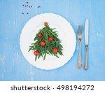 christmas tree made of arugula... | Shutterstock . vector #498194272