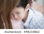 asian mother embracing and... | Shutterstock . vector #498210862