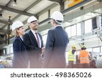 businessmen shaking hands with... | Shutterstock . vector #498365026