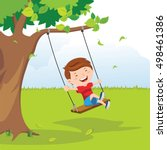 little boy on swing under a tree | Shutterstock .eps vector #498461386