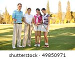 Happy group of golf players outdoors and smiling - stock photo